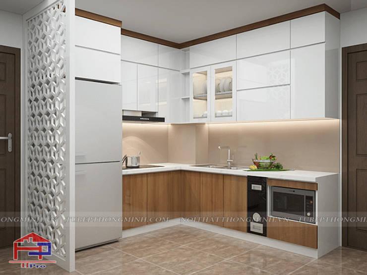 Ảnh thiết kế 3D tủ bếp acrylic kết hợp laminate và vách ngăn CNC nhà Mrs.Huyền ở Hoàng Cầu:  Kitchen by Nội thất Hpro