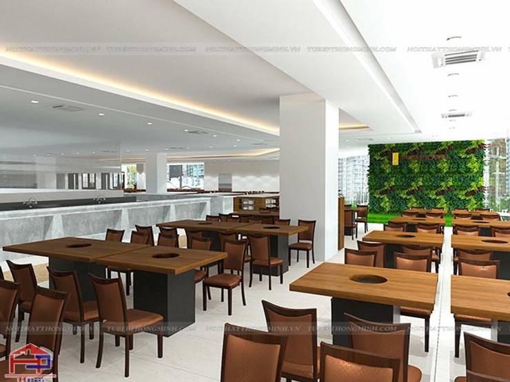 Thiết kế nội thất laminate nhà hàng Buffet Poseidon cơ sở 2 - Khu vực trung tâm dành cho thực khách:  Office spaces & stores  by Nội thất Hpro