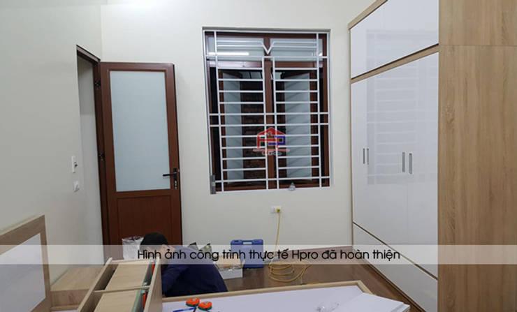 Hoàn thiện lắp đặt nội thất phòng ngủ bé gái gỗ laminate nhà chị Hương ở Việt Trì:  Bedroom by Nội thất Hpro