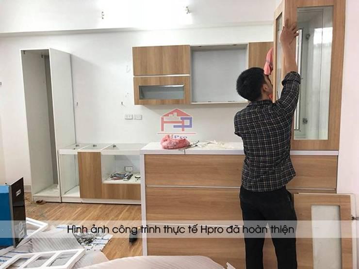 Lắp đặt tủ bếp laminate kèm quầy bar nhà anh Lộc ở Cầu Giấy:  Kitchen by Nội thất Hpro
