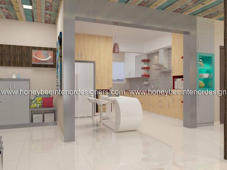 Kitchen view from Living area:  Kitchen units by Honeybee Interior Designers