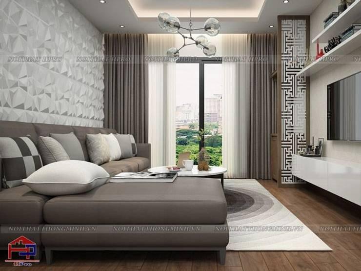 Ảnh 3D thiết kế nội thất phòng khách gỗ melamine nhà chú Quang ở tòa Ruby1 Goldmark City:  Living room by Nội thất Hpro
