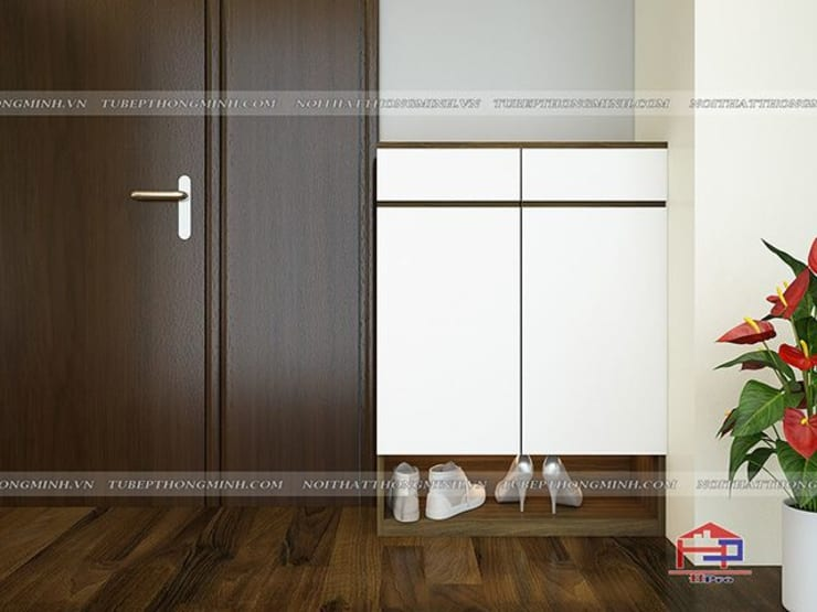 Ảnh 3D thiết kế tủ giày gỗ melamine nhà anh Thảo ở Ngoại Giao Đoàn:  Living room by Nội thất Hpro