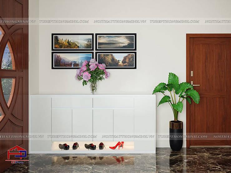 Ảnh 3D thiết kế tủ giày gỗ melamine màu trắng nhà anh Trí ở Nam Định:  Living room by Nội thất Hpro