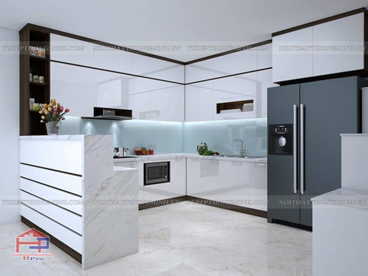 Ảnh thiết kế 3D tủ bếp acrylic kèm quầy bar nhà chị Hương ở Sơn La:  Kitchen by Nội thất Hpro