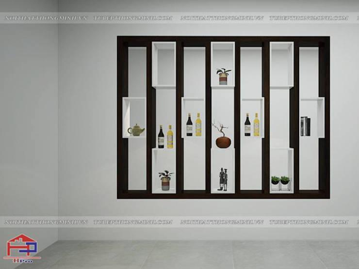 Thiết kế vách ngăn phòng khách gỗ melamine 2 nhà anh Thủy ở Hải Phòng:  Living room by Nội thất Hpro