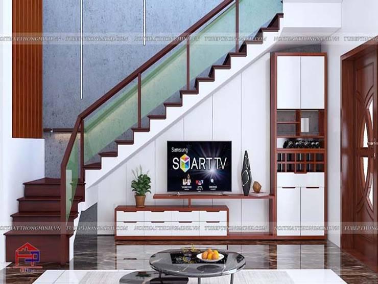 Ảnh 3D thiết kế nội thất phòng khách tầng 1 nhà anh Lý ở Vinh:  Living room by Nội thất Hpro