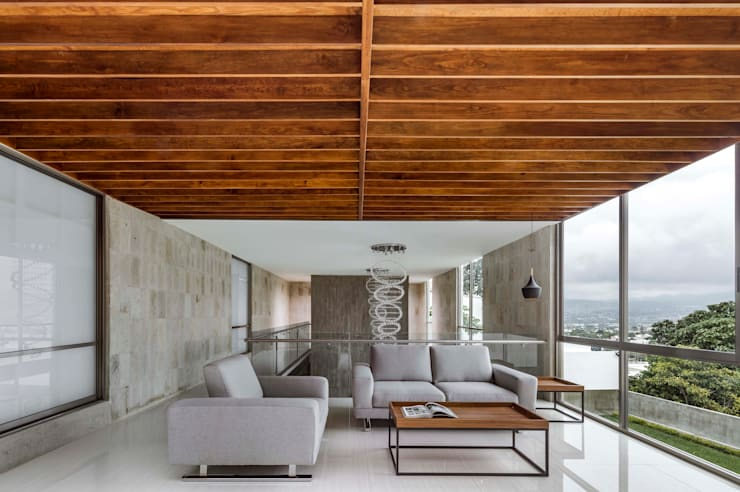 Salas / recibidores de estilo  por Apaloosa Estudio de Arquitectura y Diseño