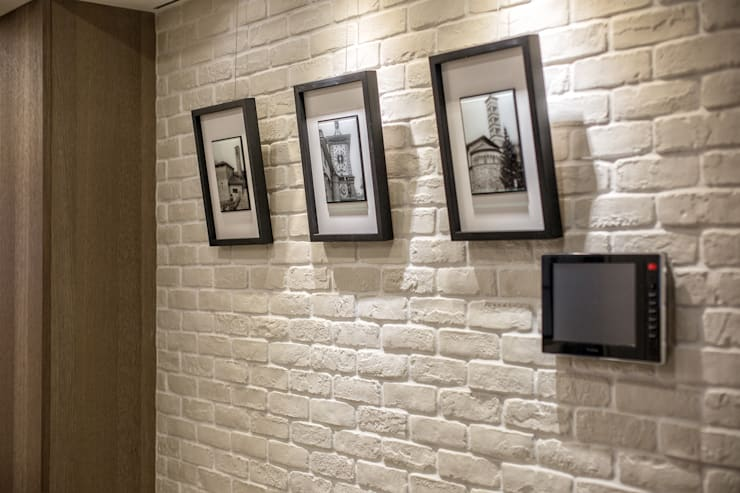 都會的鄉村風-富都新紳:  牆面 by 富亞室內裝修設計工程有限公司