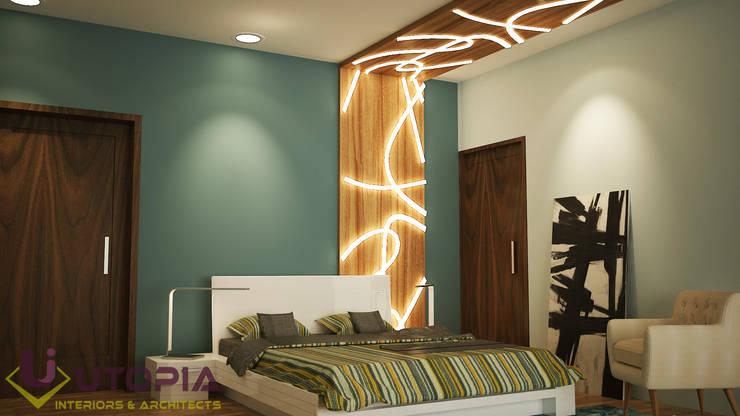 Interior design for MR.Sanjay:  Bedroom by Utopia Interiors & Architect,