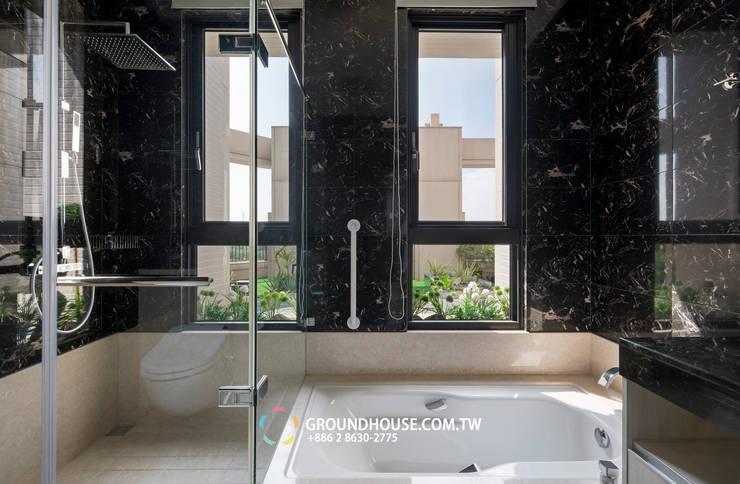 浴室窗外的風景:  浴室 by 大地工房景觀公司