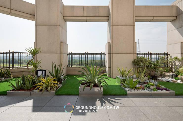 露臺的景觀與大樓外的景觀合而為一:  花園 by 大地工房景觀公司