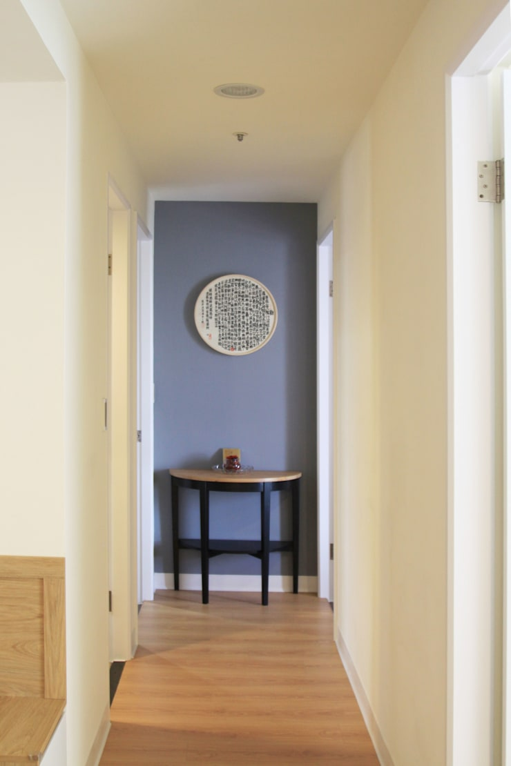 古典美女:  玄關、走廊與階梯 by 長城工程設