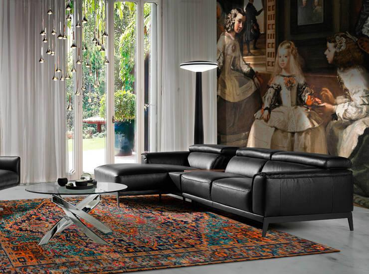 Sofá chaiselong tapizado en piel colección INCANTO SOFÁS by Angel Cerdá: Salones de estilo  de ANGEL CERDA