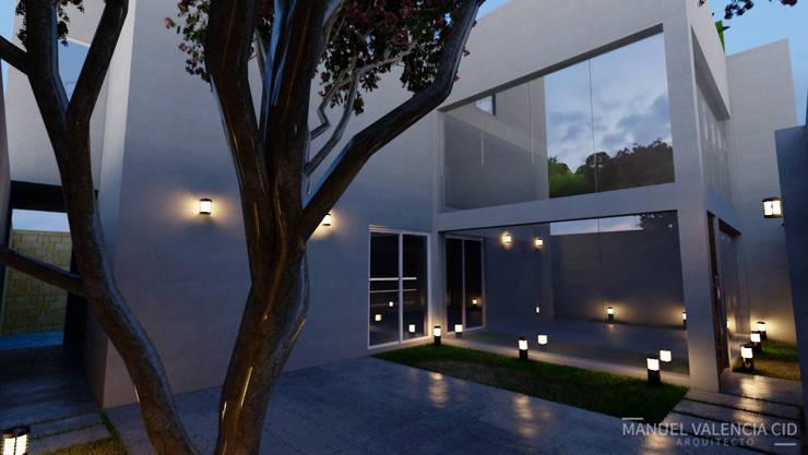 Casas unifamiliares de estilo  por ARQUITECTO MANUEL VALENCIA CID