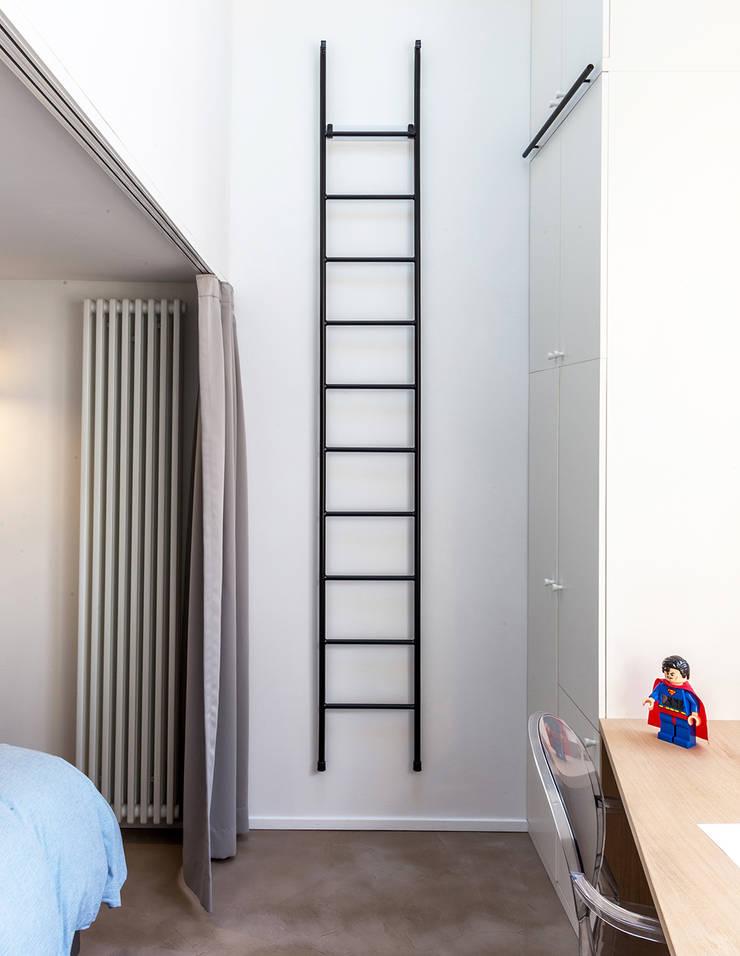 Loft à l'esprit industriel: Petites chambres de style  par Créateurs d'interieur