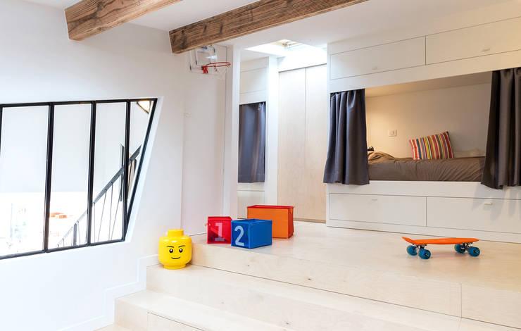 Loft à l'esprit industriel: Chambre garçon de style  par Créateurs d'interieur