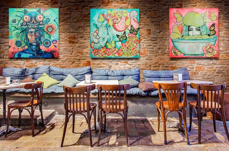 Decoración con arte en restaurante informal: Restaurantes de estilo  por Arca México