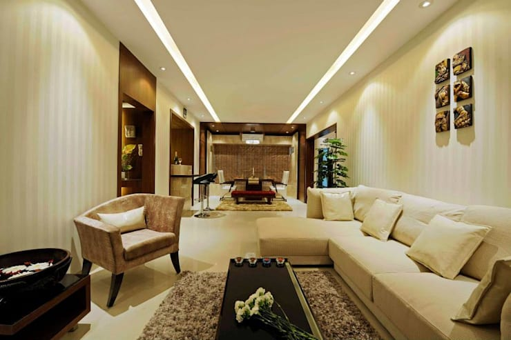 Residential Interior Designing:  Living room by Olive Interiors