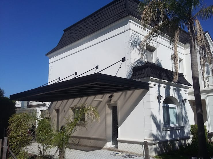 cochera barrios Los alisos NorDElta: Garajes de estilo  por sinnic,