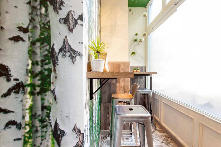 Office spaces & stores  by Estudio Mercedes Arce