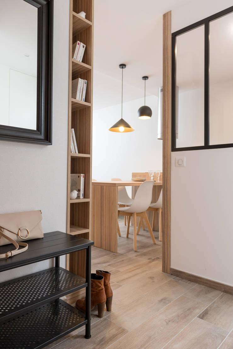 Chez Sophie et Philippe: Couloir et hall d'entrée de style  par Camille BASSE, Architecte d'intérieur,