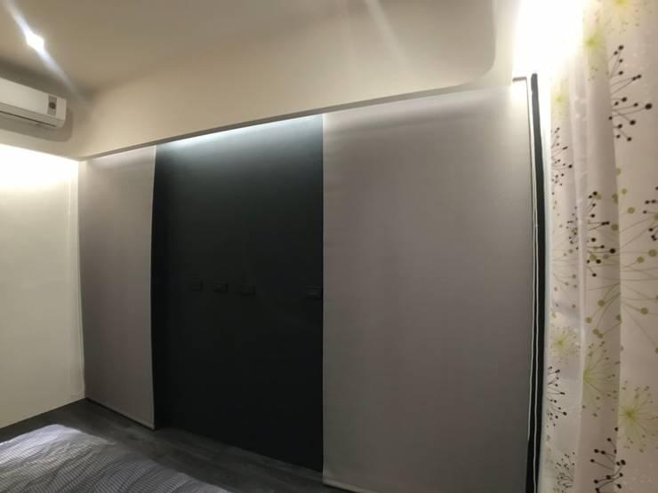 主臥電視牆變化後:  臥室 by 台中室內設計裝修 心之所向設計美學工作室