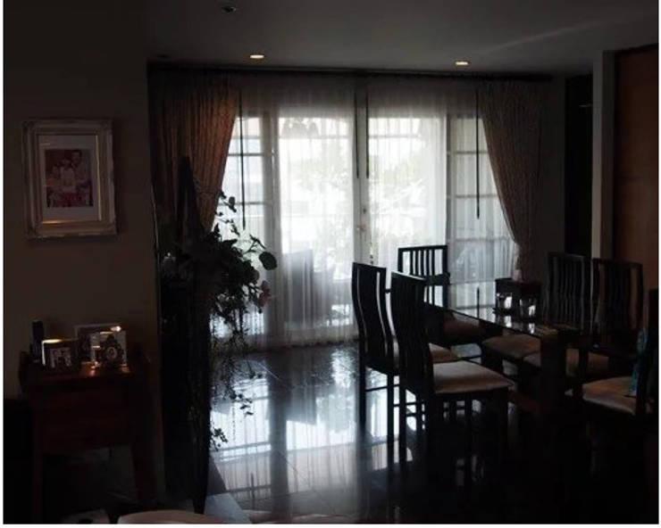 Ruamrudee Condominium Renovation:  Dining room by UpMedio Design