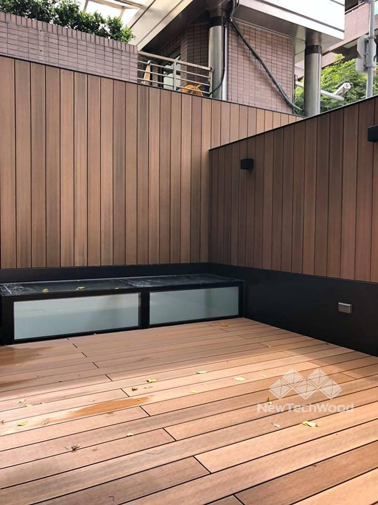 庭院地面與牆面:  庭院 by 新綠境實業有限公司