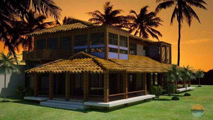 Fachada de casa de praia com varanda contínua: Casas  por 5CINQUE ARQUITETURA LTDA