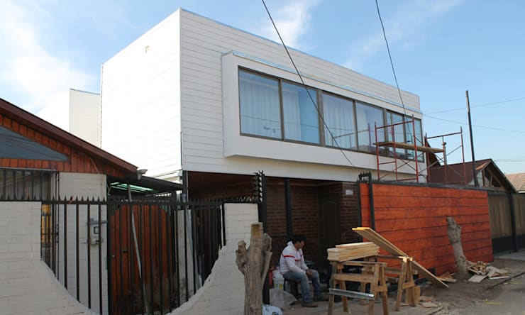 FACHADA BOW WINDOWS: Casas unifamiliares de estilo  por Vetas Sur,