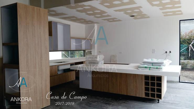 cocina de ANKORA ARQUITECTOS Moderno Granito