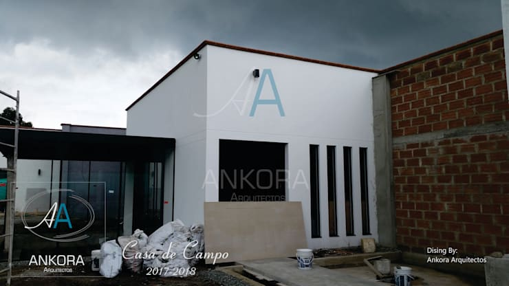 construcción de ANKORA ARQUITECTOS Moderno Concreto