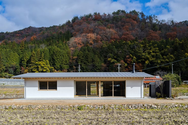 Wooden houses by WADAGUMI,