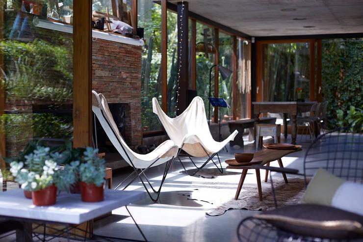 CASA OLIVOS: Livings de estilo  por STICOTTI,