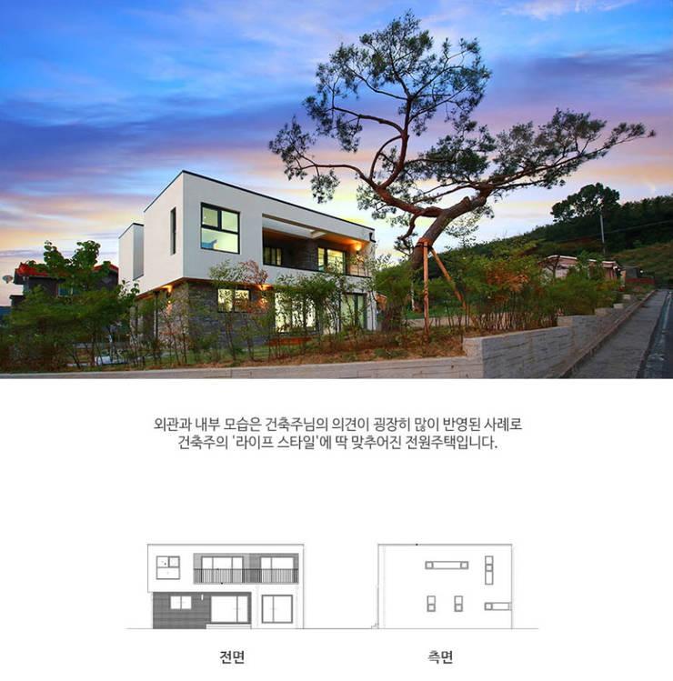 [경북 경산시] 작은정원 '중정'을 품다_야경: 한글주택(주)의  주택,