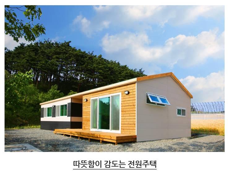 따뜻함이 감도는 전원주택: 공간제작소(주)의  단층집,