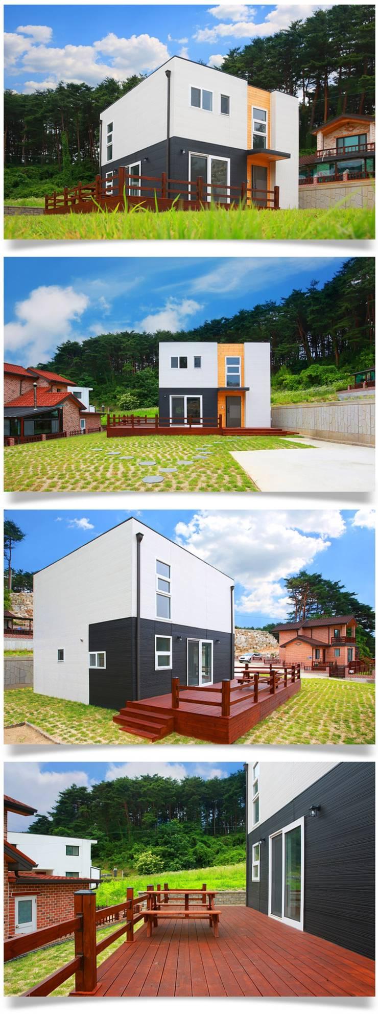 평화로운 마을과 조화를 이루는 전원주택_외관: 공간제작소(주)의  목조 주택,