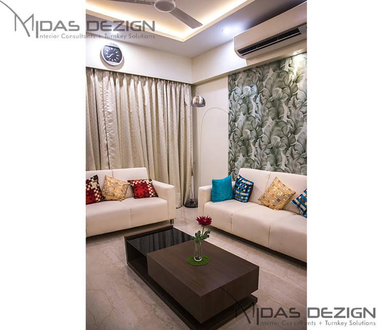 3BHK @ ALTA MONTE MALAD EAST:  Living room by Midas Dezign