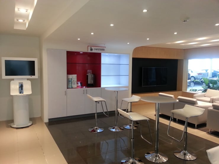 Sala VIP KIA: Oficinas y tiendas de estilo  por areaxmetro