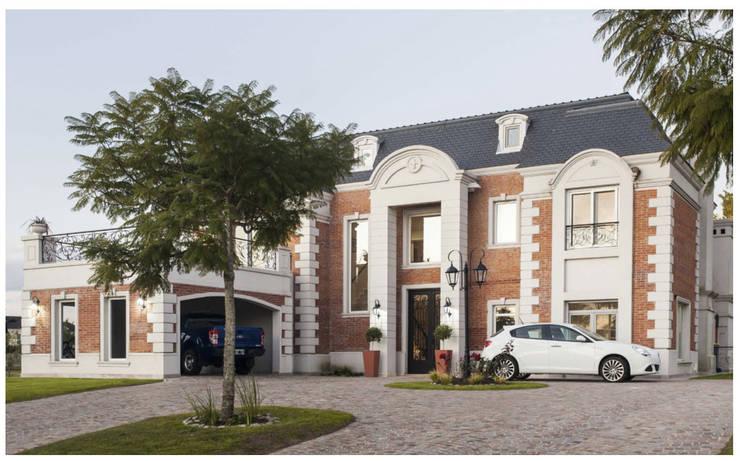 Diseño de casa estilo victoriano por CIBA: Casas unifamiliares de estilo  por CIBA ARQUITECTURA,