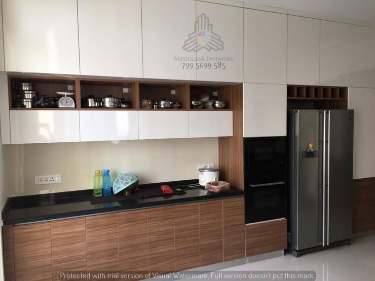 Kitchen working counter:  Kitchen by Meticular Interiors LLP,Modern