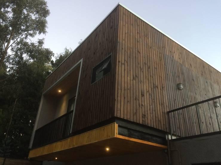 Fachadas: Casas de estilo  por Manuel Herrera