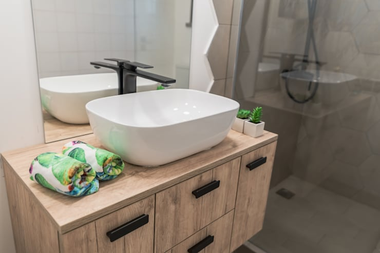 Casa de banho remodelada : Casas de banho  por Rima Design