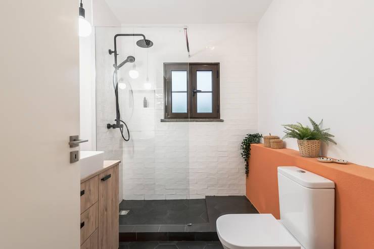 Casa de banho reabilitada - Suite : Casas de banho  por Rima Design