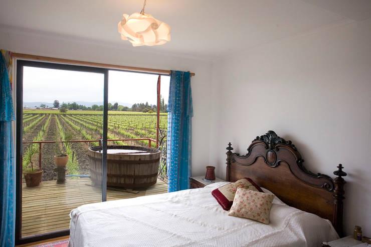 Vivienda Ecoloft Curicó: Dormitorios de estilo  por INFINISKI