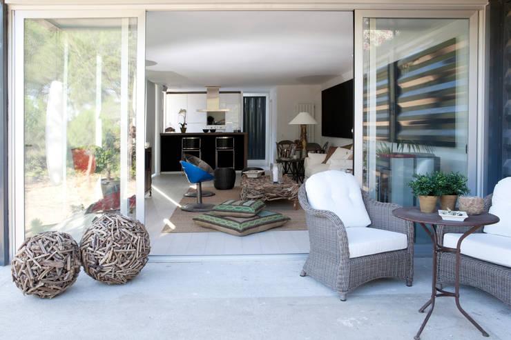 Terraza: Terrazas  de estilo  por INFINISKI
