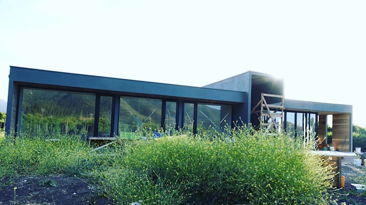 Casa Hijuelas: Casas unifamiliares de estilo  por MMAD studio - arquitectura & mobiliario -