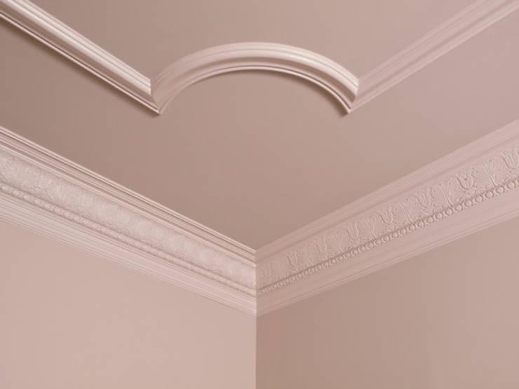 Detalle Molduras: Paisajismo de interiores de estilo  por Tau Construcciones,
