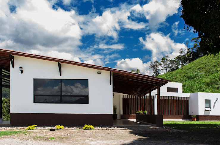 Casas de estilo rural de EVA Arquitectos SAS Rural